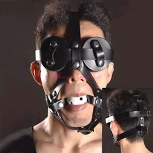 Male wearing a Full face leather ball gag head harness