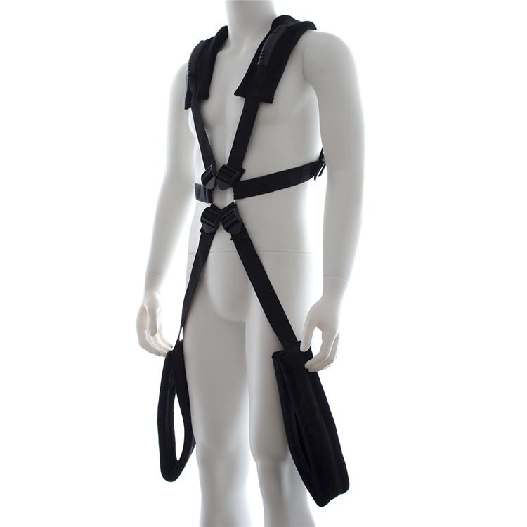 Man with around the neck sex sling on, with partner positioned in front using the harness to hold herself in place