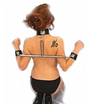 Women kneeling with a position collar spreader bar with wrist restraints.